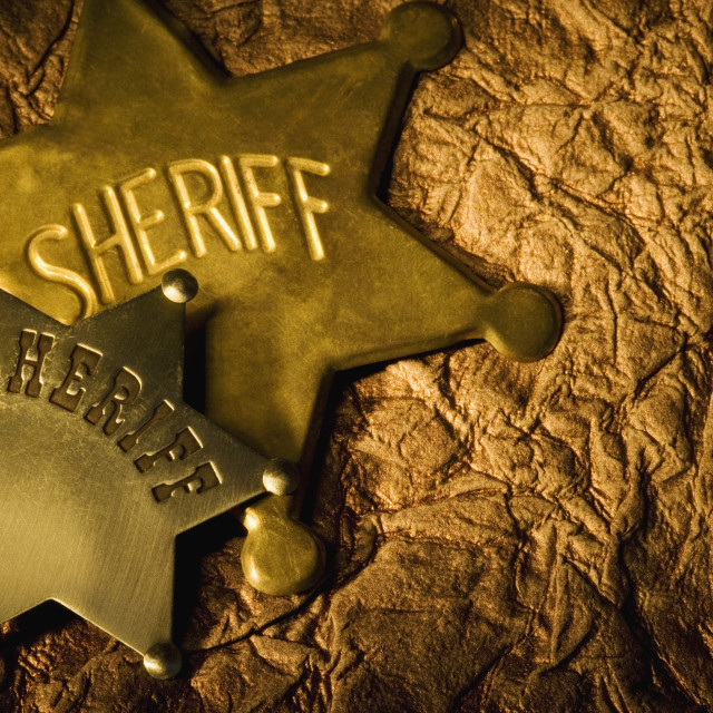 """Two Overlapping Sheriff's Badges"" stock image"