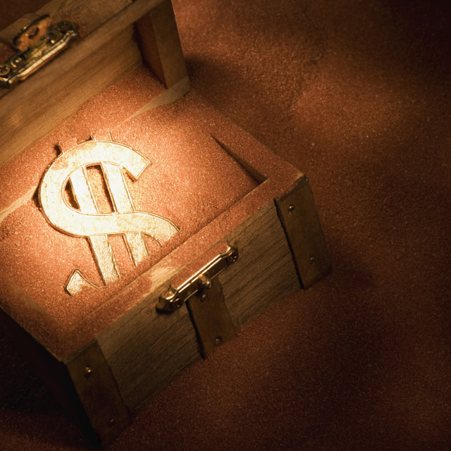 """Treasure Chest In Sand With Dollar Sign In It"" stock image"