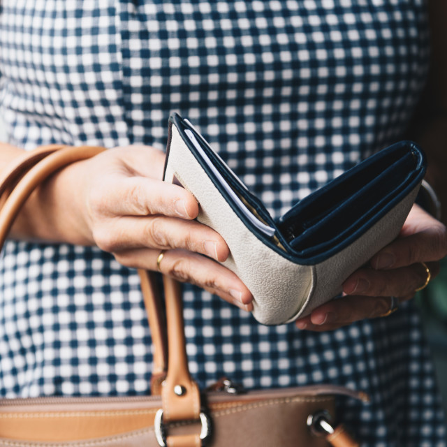 """Closeup photo of stylish woman taking the wallet out of handbag."" stock image"