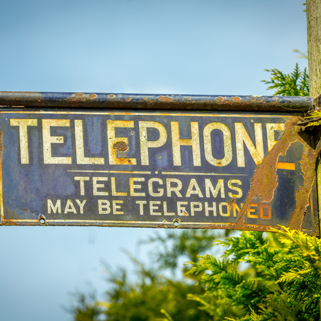 """old telephone sign in English village"" stock image"