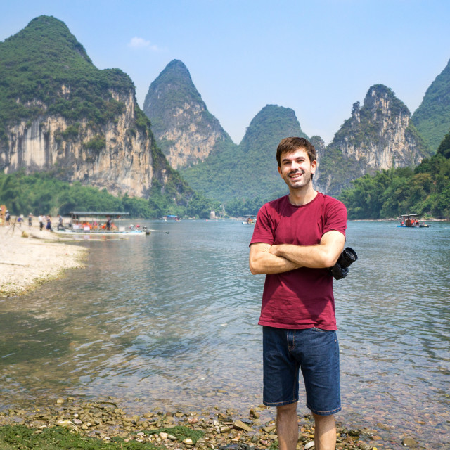 """Tourist by the Li river in Yangshuo, China"" stock image"