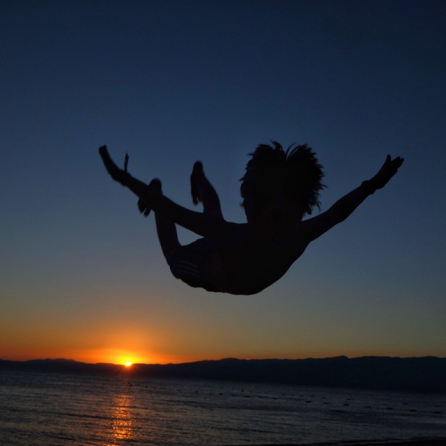 """jumping at sunset"" stock image"