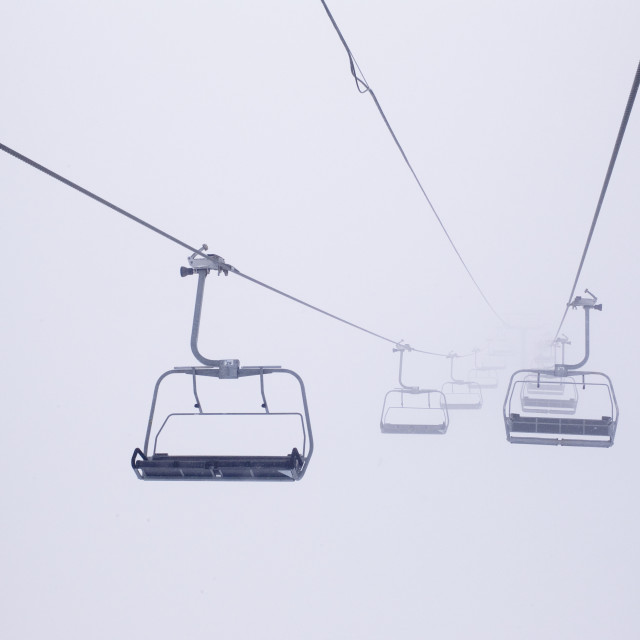 """Ski Lift Chairs In The Fog"" stock image"