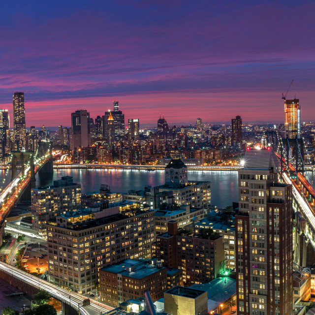 """View over Manhattan and Brooklyn skyline during sunset"" stock image"