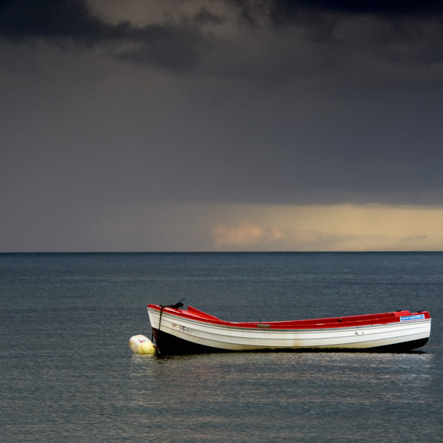 """""""Empty Boat Floating In The North Sea, Sunderland, Tyne And Wear, England"""" stock image"""