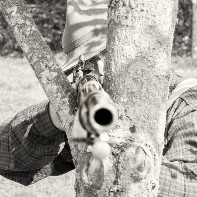 """American Civil War Re-enactor Aiming Gun at Camera"" stock image"