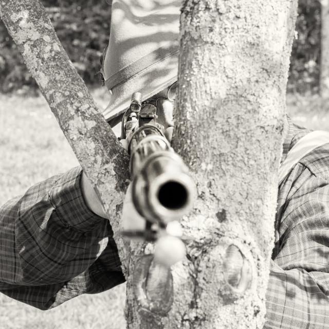 """""""American Civil War Re-enactor Aiming Gun at Camera"""" stock image"""