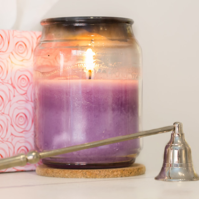 """A Scented Candle and Snuffer"" stock image"