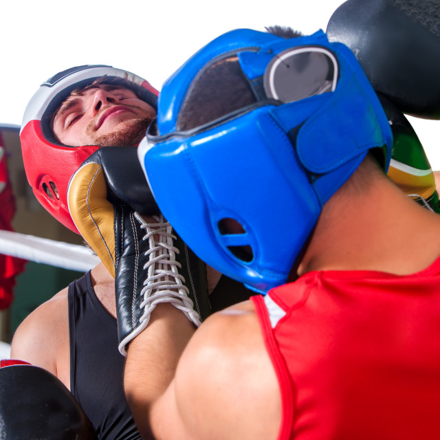 """Two men boxer wearing helmet boxing ."" stock image"