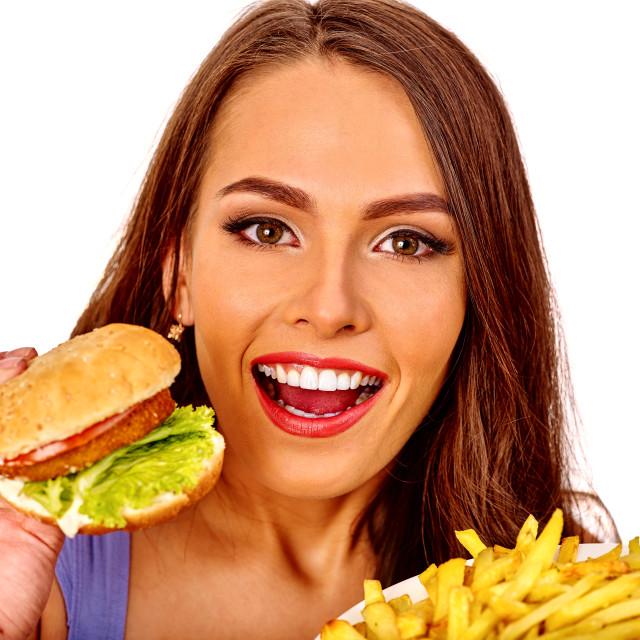 """""""Girl eating big sandwich."""" stock image"""