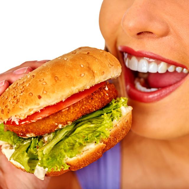 """Girl eats big hamburger fast food."" stock image"