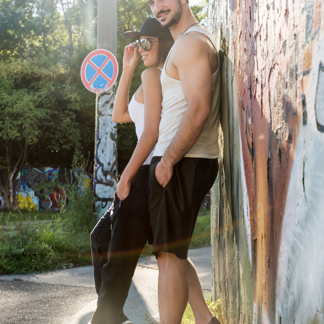 """""""Young Couple leaning against a wall in a urban environment"""" stock image"""