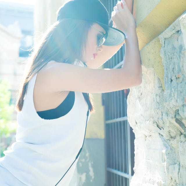 """""""Hip hop girl with headphones in a urban environment"""" stock image"""