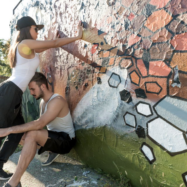 """""""Young Couple standing at a wall in a urban environment"""" stock image"""