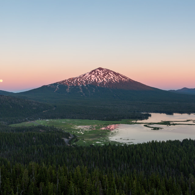 """Full Moon Rises by Mountain at Sunset"" stock image"