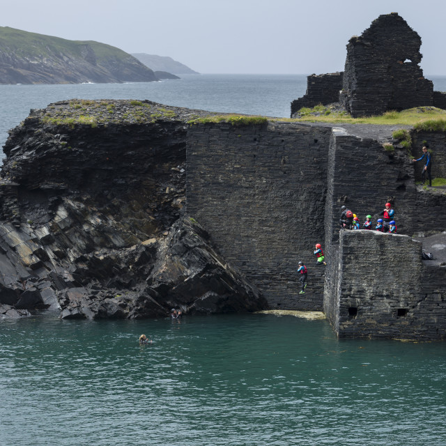 """""""Coasteering activity with people jumping from the former quarry building at..."""" stock image"""