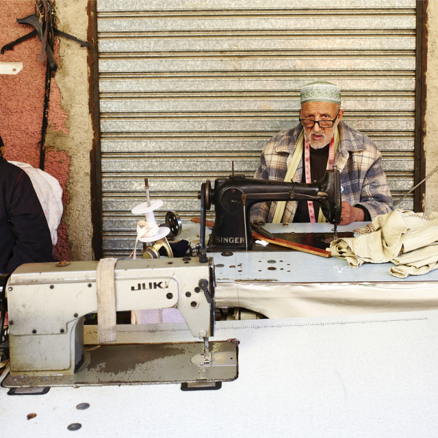 """A street tailor sewing clothes in the Medina of Meknes, Morocco"" stock image"