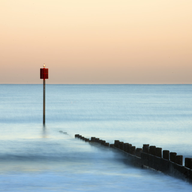 """Groyne and post at sunset on Blyth Beach, Blyth, Northumberland, England"" stock image"
