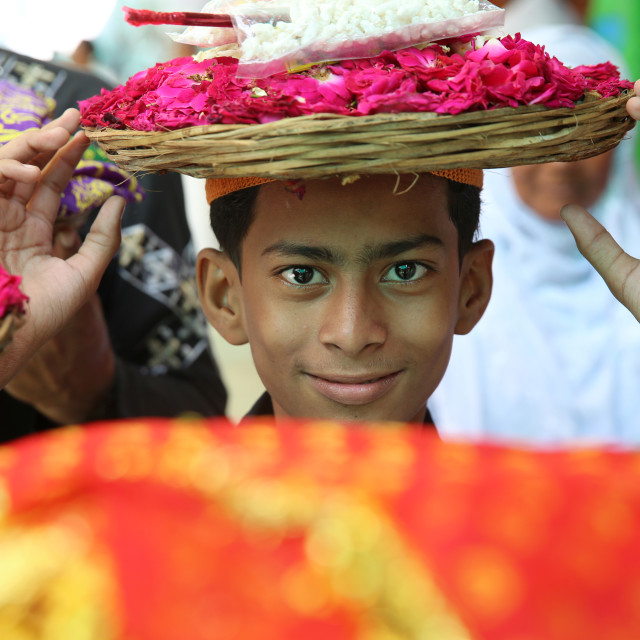 """Ajmer Sharif dargah, Rajasthan. Boy carrying offerings. India."" stock image"