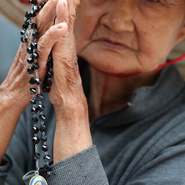 """Ho Chi Minh city. St Philip church ( Huyen Sy Church ). Old vietnamese woman..."" stock image"