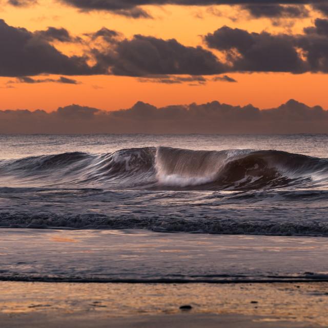 """""""Wave at danish coastline during sunset"""" stock image"""