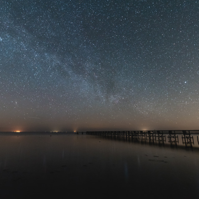 """""""Milky way over water with a Pier"""" stock image"""