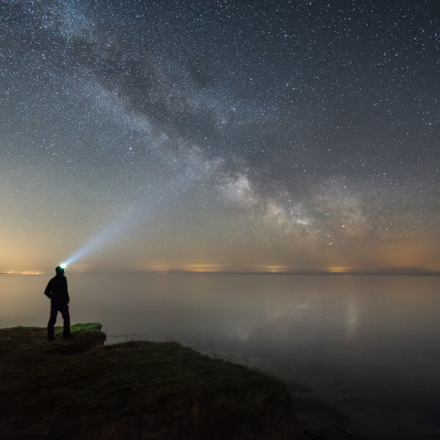 """Man silhouette admiring the milky way"" stock image"