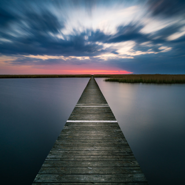 """""""Old wooden pier on calm lake at sunset"""" stock image"""