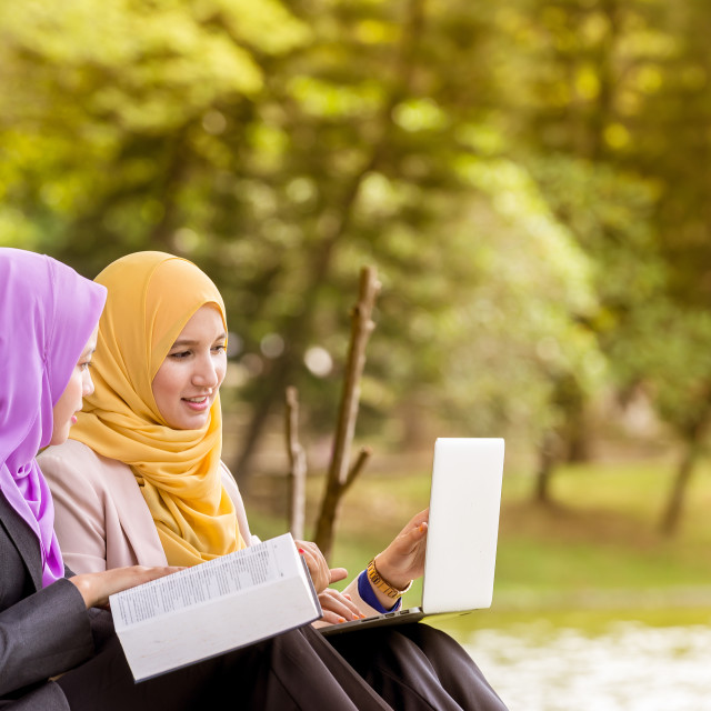 """Muslim students discussing"" stock image"