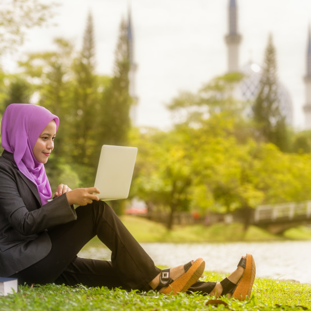 """Muslim Students with her laptop"" stock image"