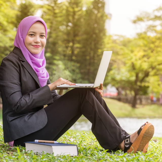 """Female Muslim Businesswoman with a laptop"" stock image"