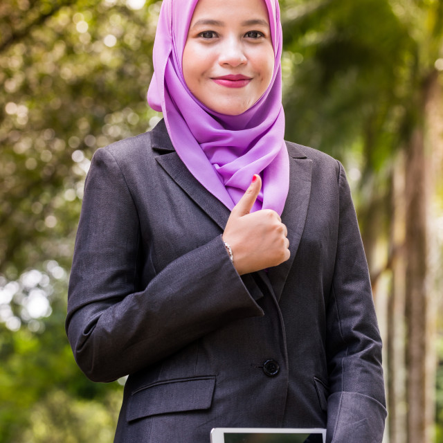 """Thumbs up by a Muslim Businesswoman"" stock image"