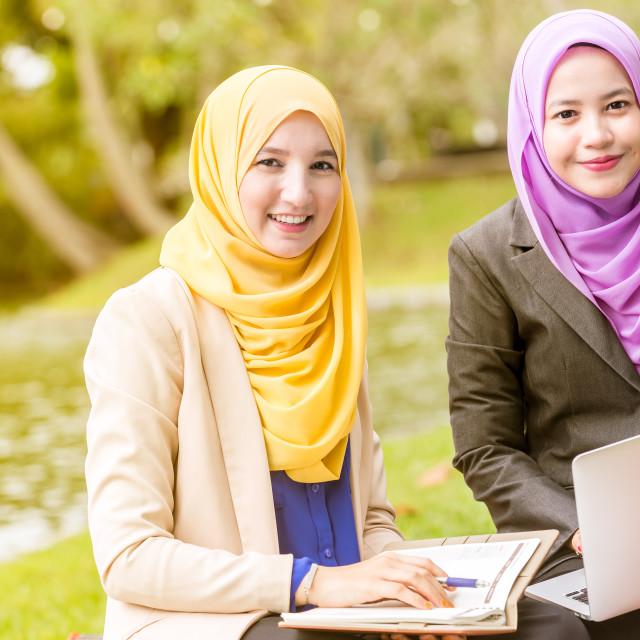 """Muslim Businesswomen looking at the camera"" stock image"