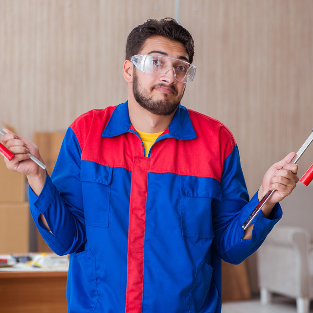 """Young repairman carpenter working with clamps"" stock image"