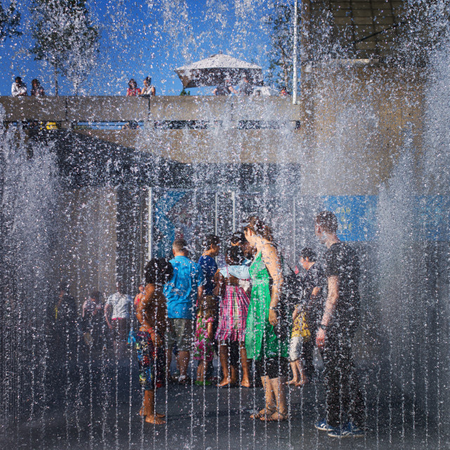 """""""Kids playing in the fountain"""" stock image"""