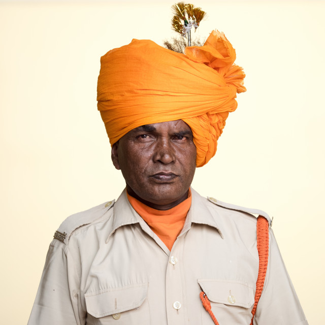 """Indian man wearing orange turban"" stock image"