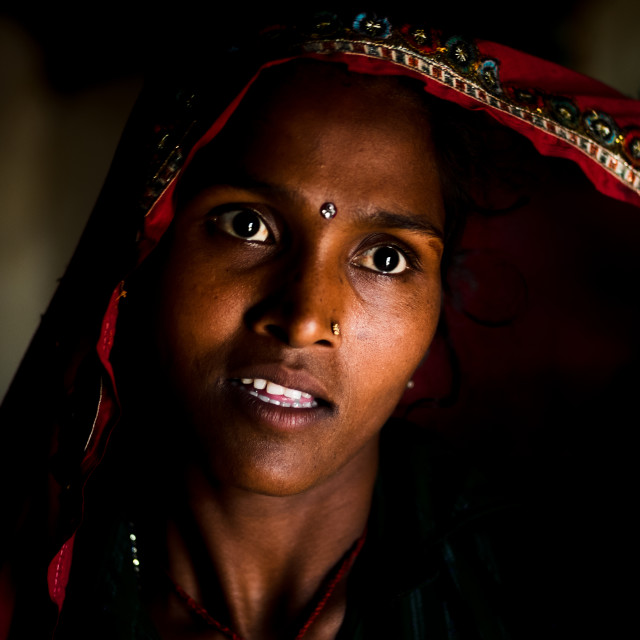 """Indian Woman in dark room"" stock image"