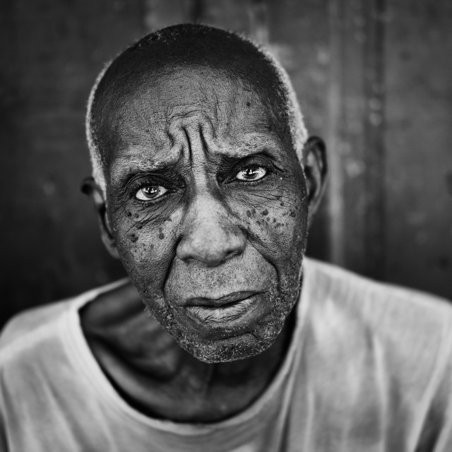 """Portrait of older Cuban man in B+W"" stock image"