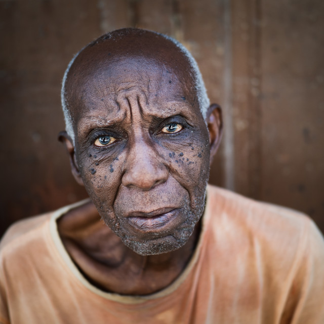 """Portrait of an older Cuban man in colour"" stock image"