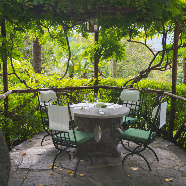 """Seating On A Restaurant Patio; Locarno, Ticino, Switzerland"" stock image"