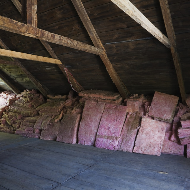 """Wooden Floor, Beams And Roof Boards With Stacked Pink Fiberglass Insulation..."" stock image"