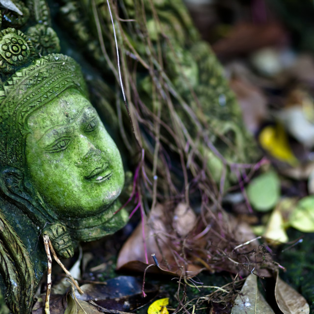 """Terra-Cotta Sculpture Of A Thai God Or Perhaps A Temple Attendant Lies In..."" stock image"