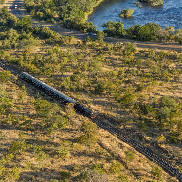 """Aerial View Of Steam Train Beside Zambezi; Botswana"" stock image"