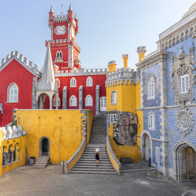 """Girl walks up Pena Palace in Sintra, Portugal"" stock image"
