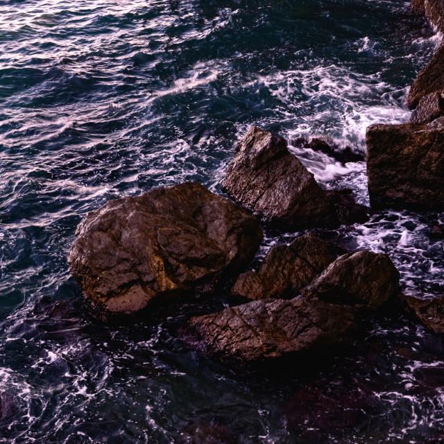 """Breaking Sea Waves near Coastal Boulders"" stock image"