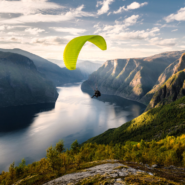 """""""Paraglider silhouette flying over Aurlandfjord, Norway"""" stock image"""