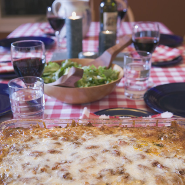 """""""Baked Lasagna On A Table Set For Dinner"""" stock image"""