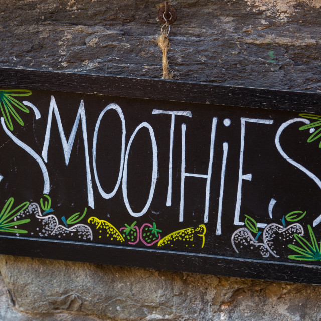 """Smoothies sign on stone wall"" stock image"