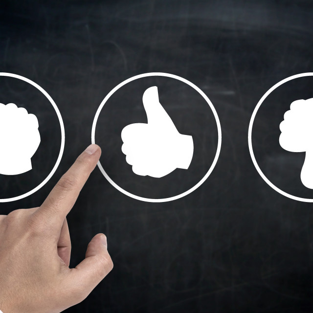 """""""Hand pointing at rating icons with thumb"""" stock image"""