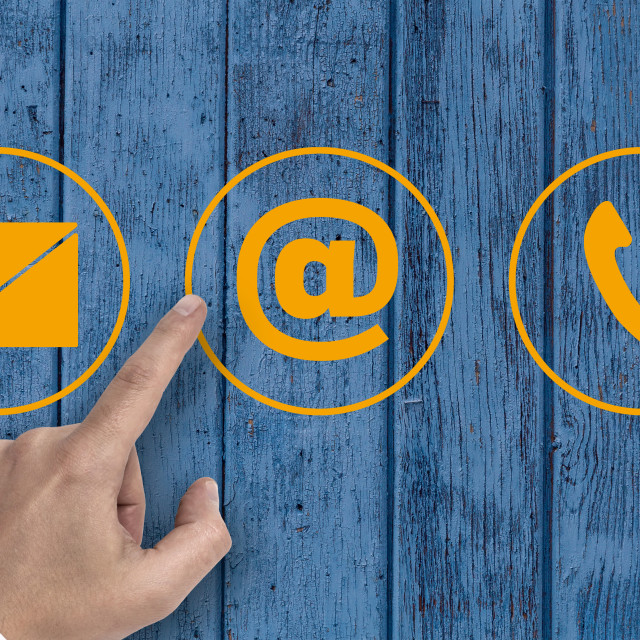 """""""Hand pointing at contact options icons e-mail letter telephone"""" stock image"""